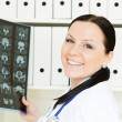 Doctor woman holding x-ray picture — Stock Photo #4852560
