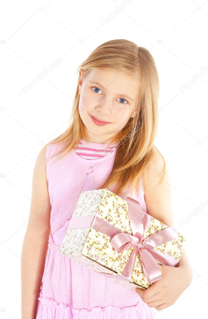 Smiling girl holding present over white background — Stock Photo #4977030