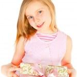 Smiling girl holding present over white — Stock Photo #5022196