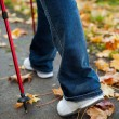 Nordic walking race on autumn trail — Stock Photo
