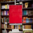 Red ad space in bookstore - many books in the background — Stock Photo