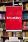 Bestsellers area in bookstore - many books in the background. — 图库照片