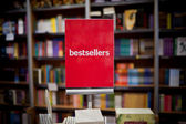 Bestsellers area in bookstore - many books in the background. — Stok fotoğraf