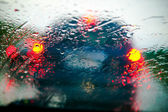 Car windshield in traffic jam during rain — 图库照片