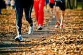 Running in the autumn race — Stock Photo