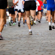 Running in city marathon - Stock Photo