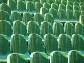 Green empty stadim seats — Photo