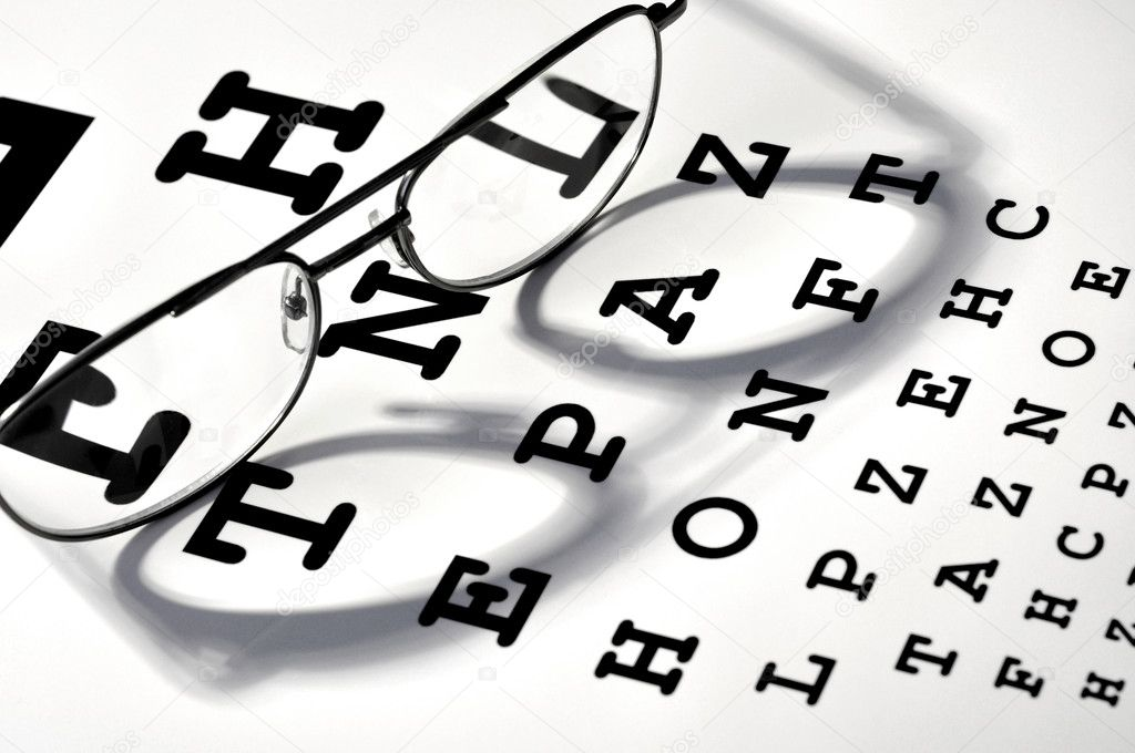 Glasses on vision test chart — Stock Photo #3947366