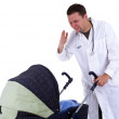 Doctor looks to baby stroller — ストック写真