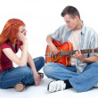 Young couple with electric guitar — Stock Photo