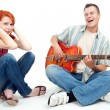 Young couple with electric guitar — 图库照片