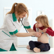 Doctor pediatrician examining little girl — Stock Photo