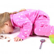 Little girl in pink pyjamas — Stock Photo