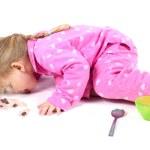 Little girl in pink pyjamas — Stock Photo