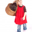 Young girl with wicker basket — Stock Photo