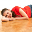 Young womon wooden floor — Stock Photo #3932414