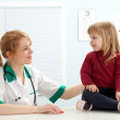 Doctor with little girl in exam room - Stock Photo