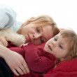 Mom with daughter sleeping — Stock Photo