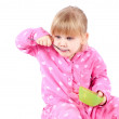 Eating little girl in pink pajamas — Stock Photo