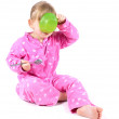 Eating little girl in pink pajamas — Stock Photo #3932629