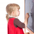Preschool girl drawing on blackboard — Stock Photo