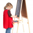 Stock Photo: Preschool girl drawing on blackboard