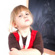Angry preschool girl with blackboard — Stock Photo #3932693