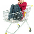 Royalty-Free Stock Photo: Young woman in shopping cart