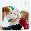 Stock Photo: Doctor pediatrician examining baby mouth
