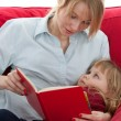 Stock Photo: mother and daughter reading