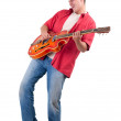 Young man playing on electric guitar - Stock Photo