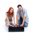 Foto Stock: Couple with big black box