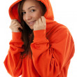Woman in sweatshirt founding hood on head - Stock Photo