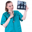 Stock Photo: Female doctor with tomography brain