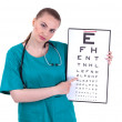 Doctor with optometry chart — Photo