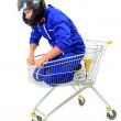 Motorcyclist in shopping cart — Stock Photo