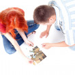 Young couple playing with puzzle — Stock Photo