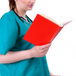 Female doctor with book — Stock Photo #3935488