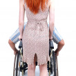 Stock Photo: Man on wheelchair woman push trolley