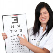 Foto Stock: Lady doctor with optometry chart