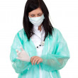Stock Photo: Doctor pulling on surgical gloves