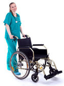 Female doctor with wheelchair — Stock Photo