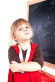 Angry preschool girl with blackboard — Stock Photo