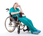 Doctor with alcohol on wheelchair — Stock Photo