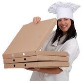 Usmíval se vařit s krabice pizzy — Stock fotografie