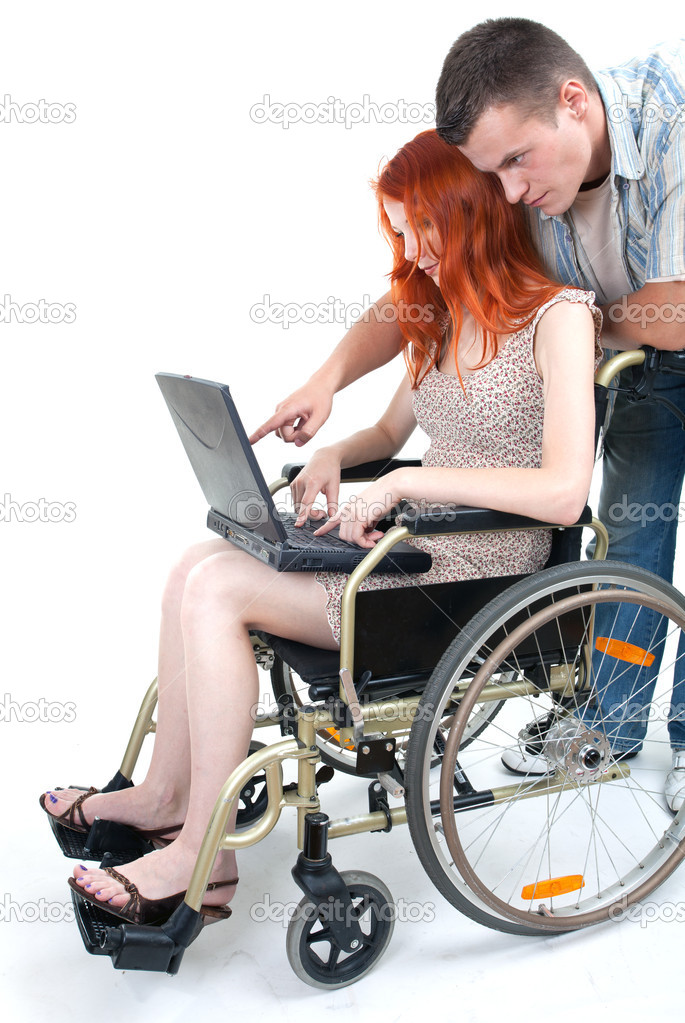 Woman with laptop on wheelchair, with man showing her something  — Stock Photo #3935505