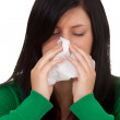Stock Photo: Woman with a runny nose