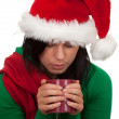 Woman in christmas hat with red cup — Stock Photo