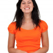 Smiling woman in orange blouse — Stock Photo