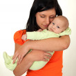 Stock Photo: Mother hugging her newborn boy